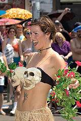 girl with skulls bra in the mermaid parade